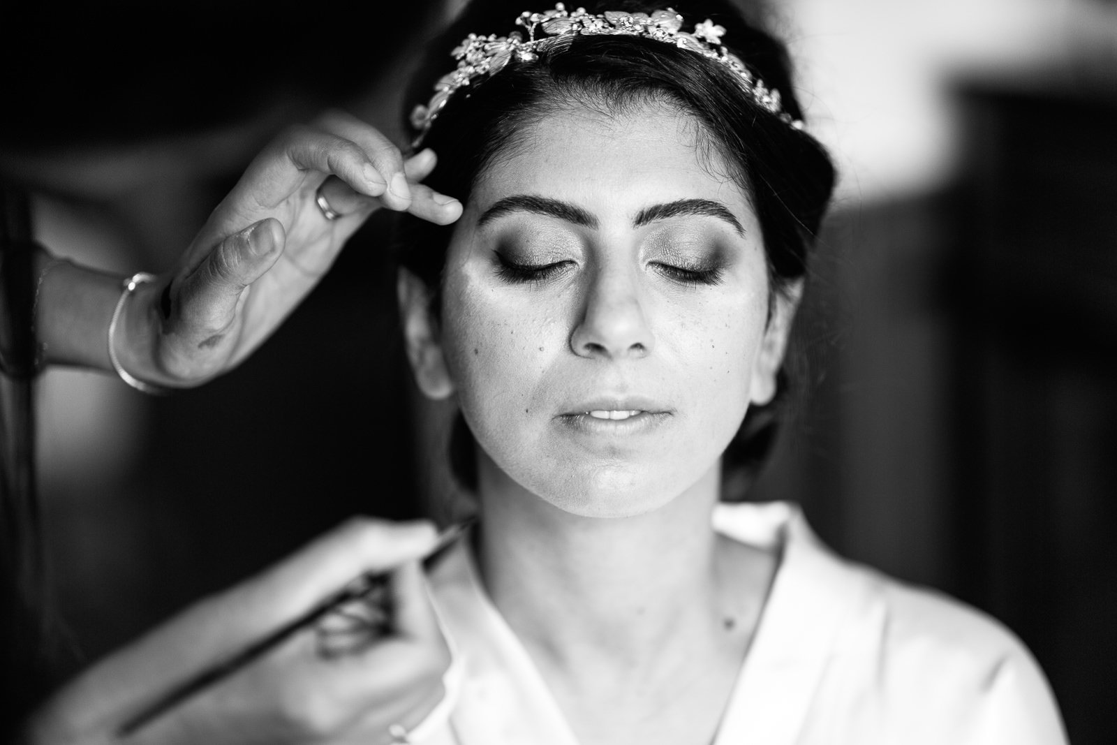 Bride getting her makeup applied